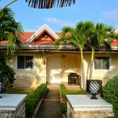 奧利維亞度假服務式公寓和別墅